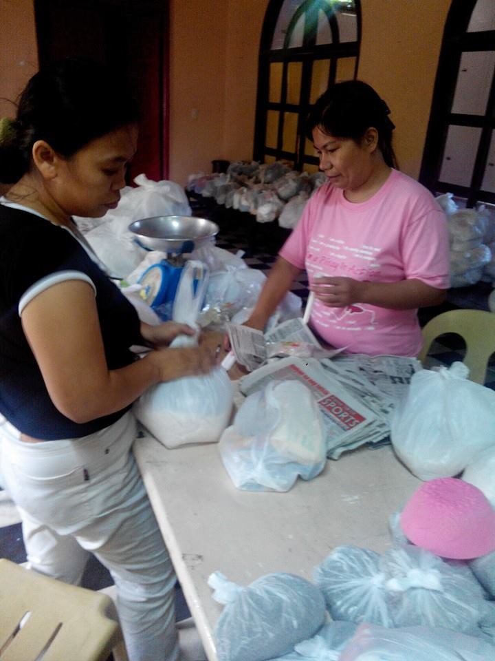 In the same room where Gota de Leche milk was prepared for distribution 95 years ago, our staff prepares rice, mongo, hygiene kits, food and candles for Northern Panay typhoon survivors.