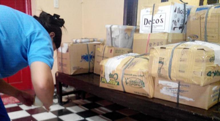 Gota de Leche staff member prepares relief goods for Yolanda victims