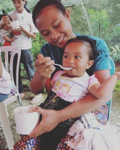 Kibungan mom feeding her baby a nutritious rice meal