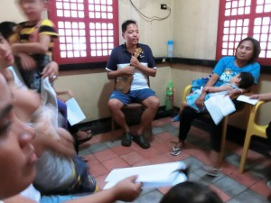 Dondi_Ong_center_facilitating_a_music_therapy_session_at_Gota_de_Leche_building